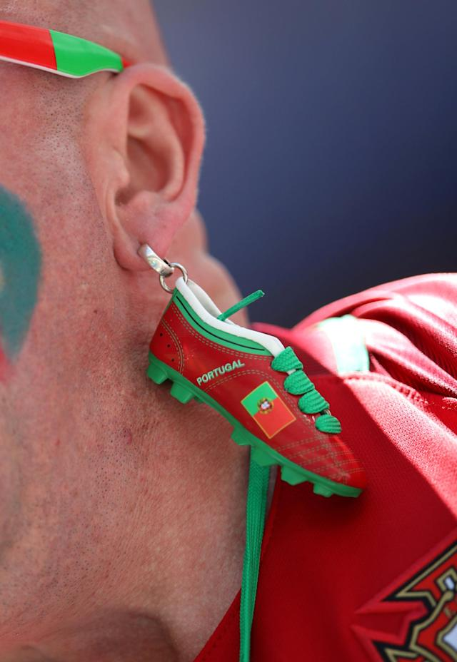 Soccer Football - World Cup - Group B - Portugal vs Morocco - Luzhniki Stadium, Moscow, Russia - June 20, 2018 General view of an earring worn by a Portugal fan inside the stadium before the match REUTERS/Carl Recine