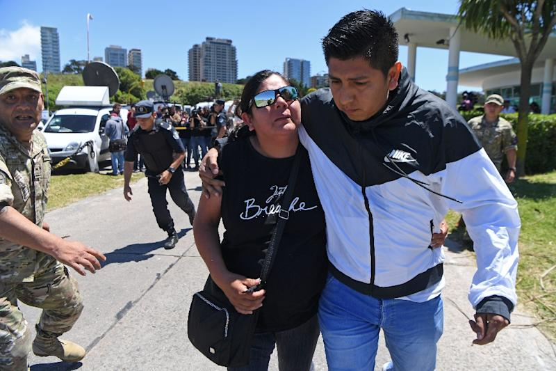 Elena Alfaro (L), a relative of missing submariner Cristian David Ibanez, arrives at Argentina's navy base in Mar del Plata on November 23, 2017, as some family members of the missing submariners accused the navy of lying to them over the crew's fate (AFP Photo/EITAN ABRAMOVICH)