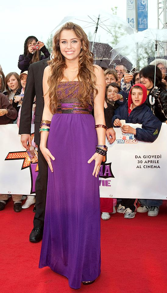 "Miley Cyrus continued to rock the red carpet at yet another ""Hannah Montana"" movie premiere in multi-colored Kara Ross bangles and a purple strapless masterpiece, courtesy of Missoni. Elisabetta Villa/<a href=""http://www.gettyimages.com/"" target=""new"">GettyImages.com</a> - April 20, 2009"