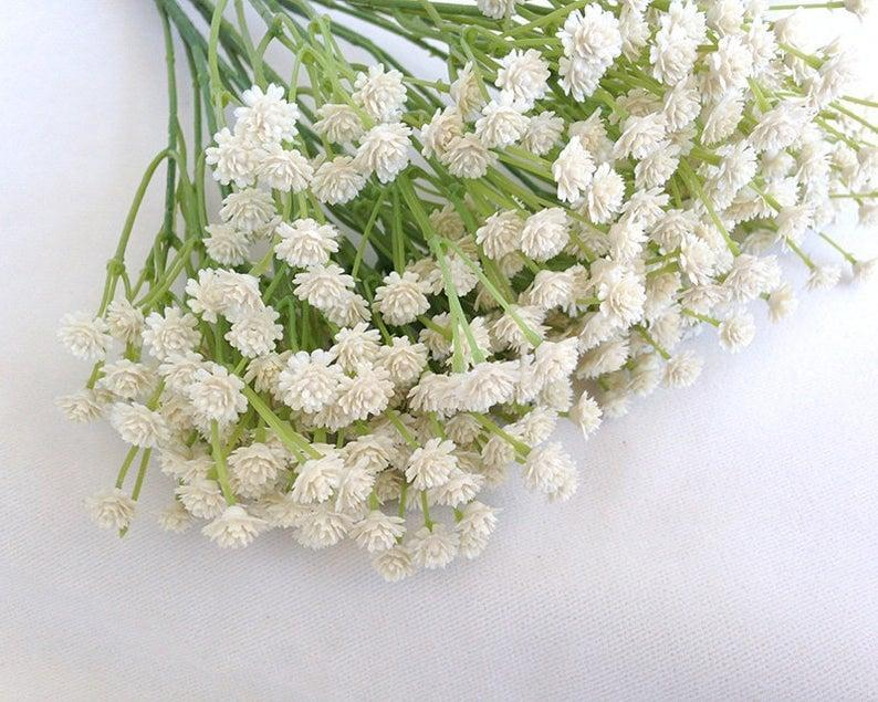 <p>Keeping fresh flowers around is amazing, but popping bundles of these very convincing <span>Faux Baby's Breath Bundles</span> ($16) in colorful vases is an easy, affordable swap. We keep them on our desk in the living room and another vase on a shelf in the kitchen. </p>