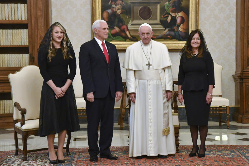 "Pope Francis poses for a photograph with US Vice President Mike Pence, second from left, his wife Karen, right, and their daughter in law Sarah, on the occasion of their private audience, at the Vatican, Friday, Jan. 24, 2020. Pence told Pope Francis, ""You made me a hero"" back home by granting him a private audience at the Vatican on Friday.  (Alessandro Di Meo/Pool Photo via AP)"