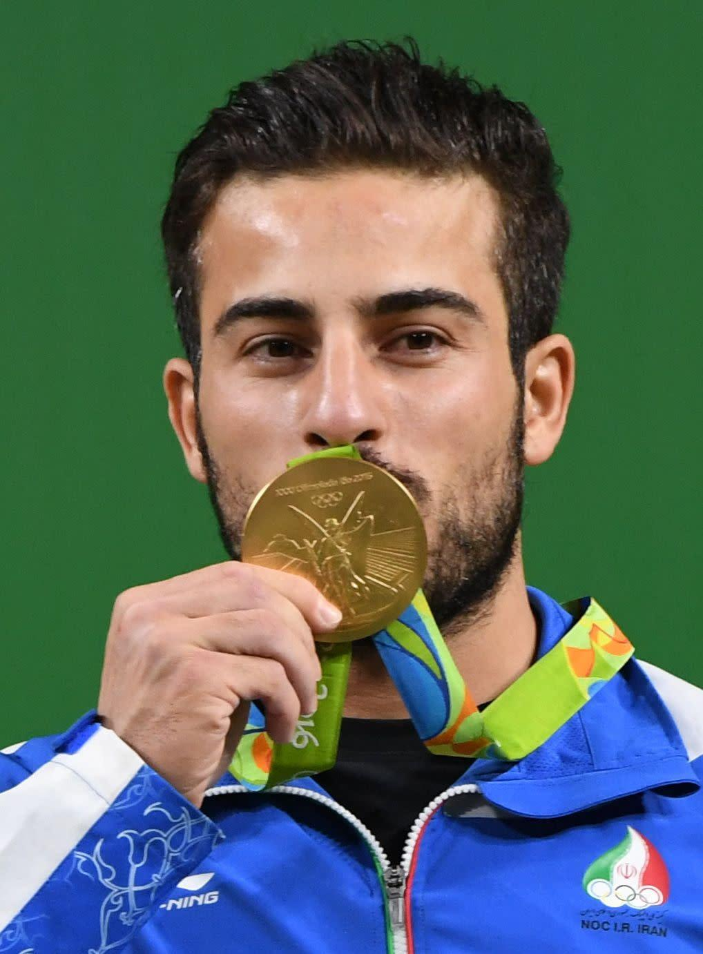 Iranian weightlifter Kianoush Rostamiwon gold at the Summer Olympics in Rio last year. (Photo: GOH CHAI HIN via Getty Images)