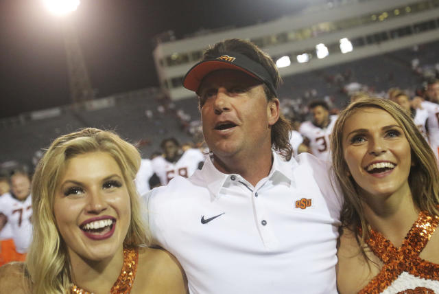 Oklahoma State Mike Gundy (C) celebrates his victory over the South Alabama onFriday, Sept. 8, 2017. (AP Photo/Dan Anderson)