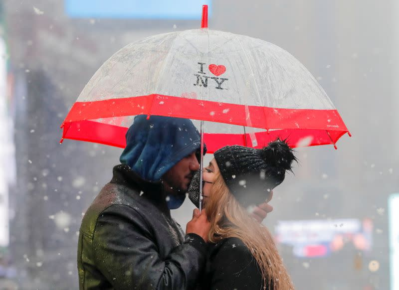 Eyad Alsous and Zugneily Santana kiss in Times Square, in New York City