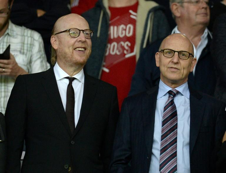 The Manchester United supporters anger was aimed at co-chairman Joel Glazer, pictured right alongside his brother Avram Glazer
