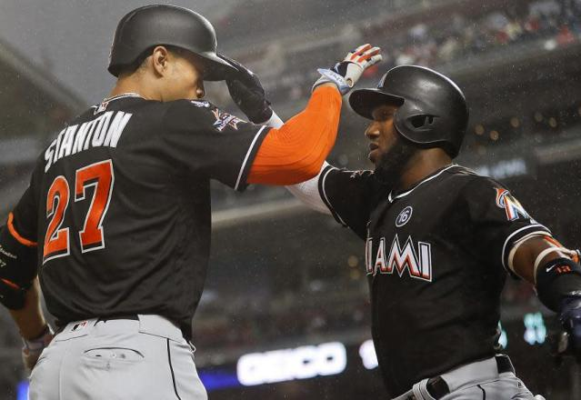 Giancarlo Stanton (left) didn't net the Marlins nearly as big a return as Marcell Ozuna (right), and that's all the Marlins fault. (AP)