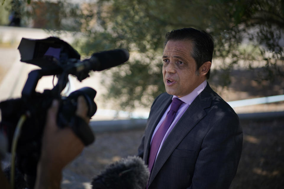 """Lawyer Javier Villalba speaks briefly with journalists on leaving the Brians 2 penitentiary center in Sant Esteve Sesrovires, near Barcelona, northeast Spain, Friday, June 25, 2021. A judge in northeastern Spain has ordered an autopsy for John McAfee, creator of the McAfee antivirus software, a gun-loving antivirus pioneer, cryptocurrency promoter and occasional politician who died in a cell pending extradition to the United States for allegedly evading millions in unpaid taxes. McAfee's Spanish lawyer, Javier Villalba, said the entrepreneur's death had come as a surprise to his wife and other relatives, since McAfee """"had not said goodbye."""" (AP Photo/Joan Mateu)"""