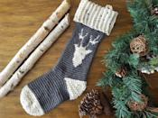 """<p>As you read <em>The Night Before Christmas </em>to your little ones, those reindeer will sound a lot closer with this wintry reindeer stocking. You can even add a red button for Rudolph's nose.</p><p><strong>Get the tutorial at <a href=""""http://www.sincerelypam.com/reindeer-stocking-cal-week-4/"""" rel=""""nofollow noopener"""" target=""""_blank"""" data-ylk=""""slk:Sincerely, Pam"""" class=""""link rapid-noclick-resp"""">Sincerely, Pam</a>.</strong></p><p><a class=""""link rapid-noclick-resp"""" href=""""https://www.amazon.com/Clover-3672-Amour-Crochet-sizes/dp/B00B2CCA6W/ref=sr_1_3?tag=syn-yahoo-20&ascsubtag=%5Bartid%7C10050.g.28872655%5Bsrc%7Cyahoo-us"""" rel=""""nofollow noopener"""" target=""""_blank"""" data-ylk=""""slk:SHOP CROCHET HOOKS"""">SHOP CROCHET HOOKS</a></p>"""