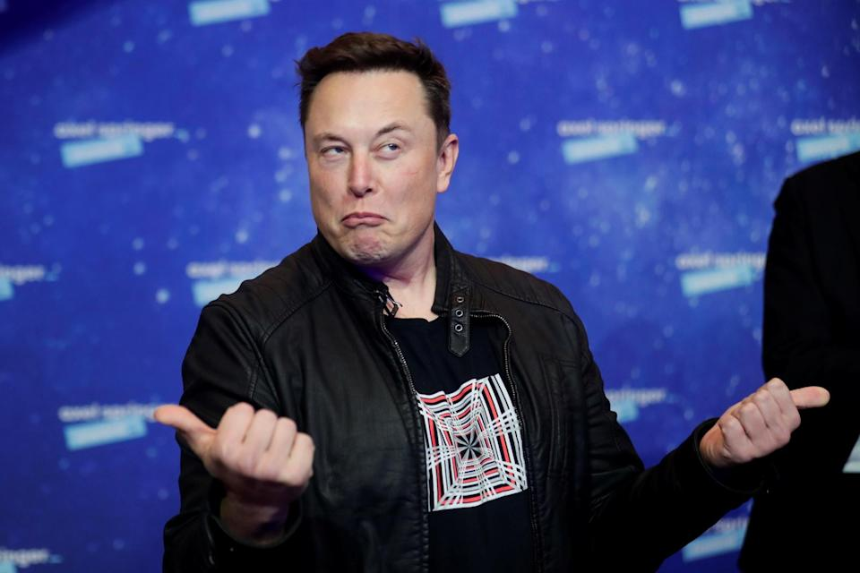 SpaceX owner and Tesla CEO Elon Musk grimaces after arriving on the red carpet for the Axel Springer award, in Berlin, Germany, December 1, 2020. REUTERS/Hannibal Hanschke/Pool - RC2IEK94IOGV