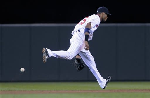 A line drive off the bat of Seattle Mariners' Trayvon Robinson gets by Minnesota Twins shortstop Pedro Florimon in the fifth inning of a baseball game, Tuesday, Aug. 28, 2012, in Minneapolis. (AP Photo/Jim Mone)