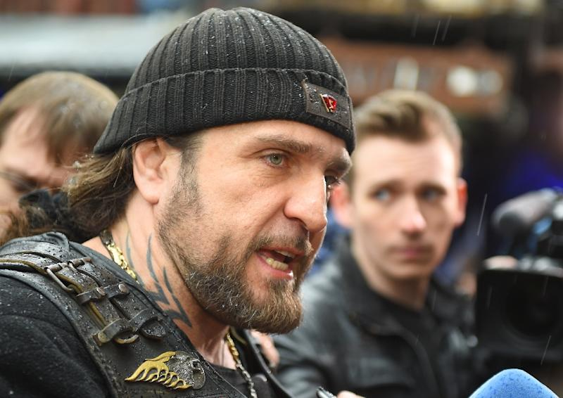 """Alexander Zaldostanov also known as """"Khirurg"""" (The Surgeon), leader of the Night Wolves bikers' club, talks to media in Moscow on April 25, 2015, before starting a ride through Europe"""