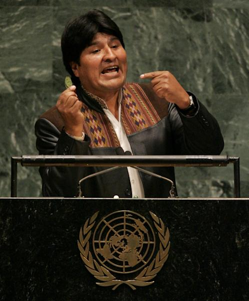 FILE- In this Tuesday, Sept. 19, 2006 file photo, Bolivian president Evo Morales holds up a coca leaf as he addresses the 61st session of the United Nations General Assembly at U.N. headquarters, Tuesday, Sept. 19, 2006. Israeli Prime Minister Benjamin Netanyahu's use of a cartoon-like drawing of a bomb to convey a message over Iran's disputed nuclear program this week, follows in a long and storied tradition of leaders and diplomats using props to make their points at the United Nations. (AP Photo/Julie Jacobson, File)
