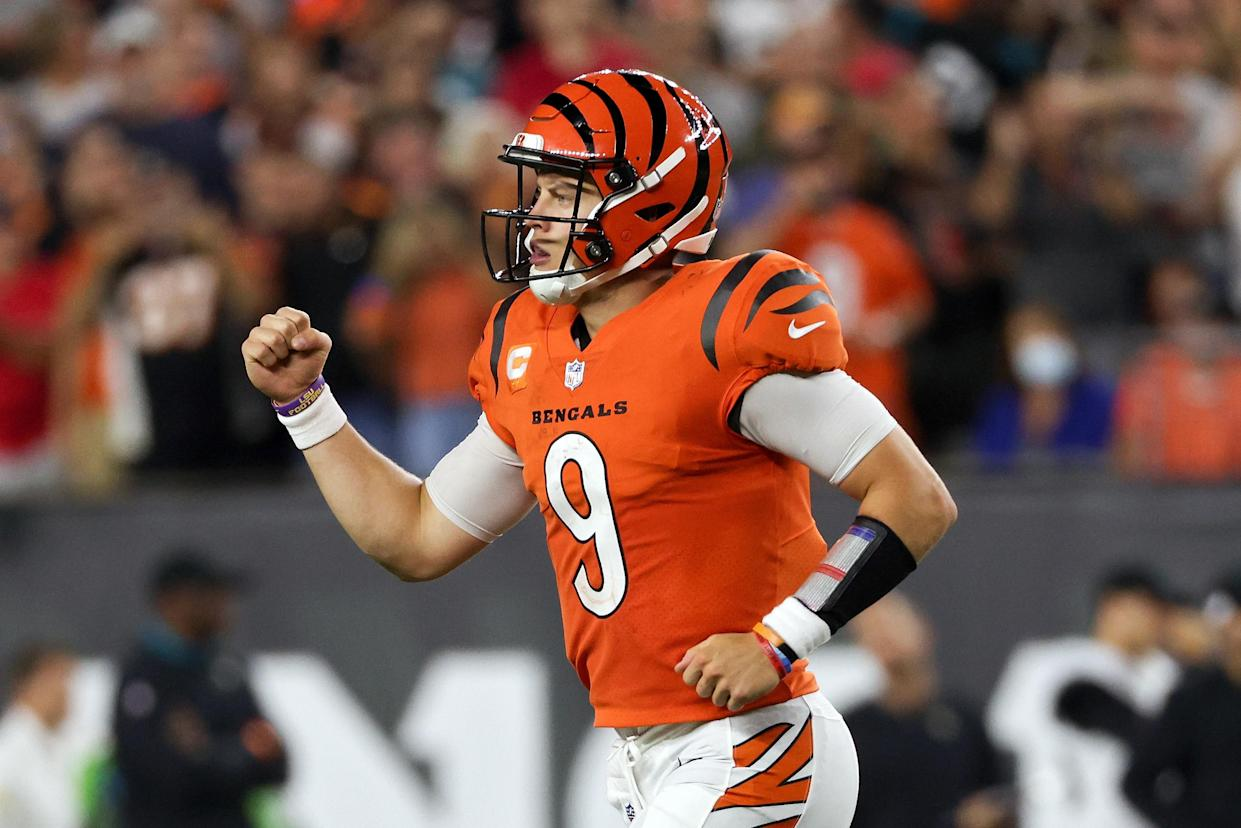 CINCINNATI, OHIO - SEPTEMBER 30: Joe Burrow #9 of the Cincinnati Bengals celebrates after scoring a touchdown in the fourth quarter against the Jacksonville Jaguars at Paul Brown Stadium on September 30, 2021 in Cincinnati, Ohio. (Photo by Dylan Buell/Getty Images)