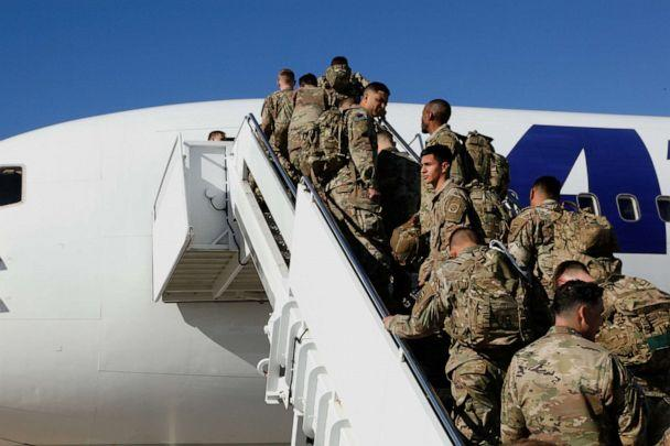 PHOTO: U.S. Army paratroopers assigned to 1st Brigade Combat Team, 82nd Airborne Division board an aircraft bound for the U.S. Central Command area of operations from Fort Bragg, North Carolina, Jan. 5, 2020. (Us Army via Reuters)