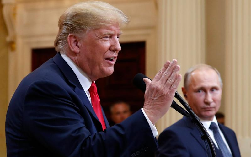 Democrats criticised Trump for failing to question Putin on the claims - Pablo Martinez Monsivais /AP
