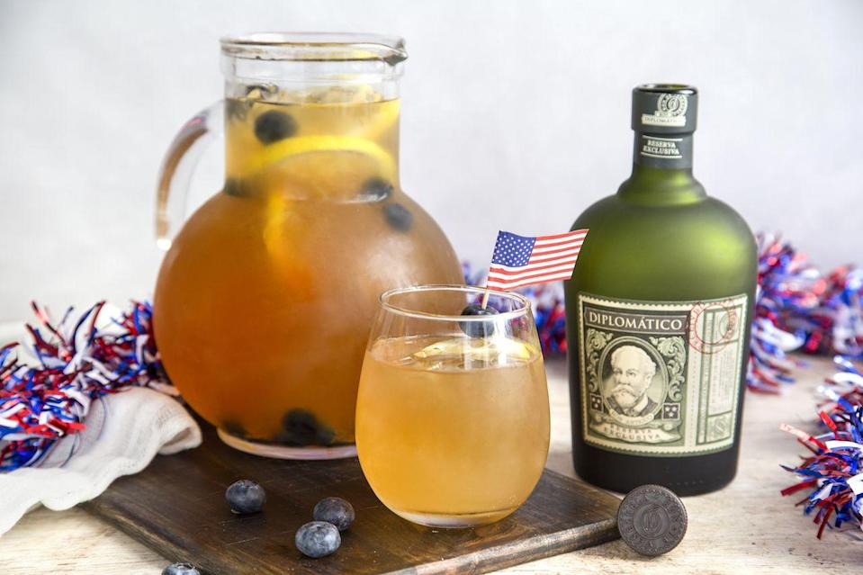 "<p><strong>Ingredients:</strong></p><p>2 cups Diplomático Reserva Exclusiva</p><p>3 cups lemonade</p><p>1 cup cold water</p><p>4-6 dashes of Angostura bitters</p><p>Lemons</p><p>Blueberries </p><p>Ice</p><p><strong>Directions:</strong></p><p>In a pitcher with ice, combine your Diplomatico Rum, lemonade and water. Add in your lemon and bitters. Finally, garnish with lemon slices and blueberries. </p><p><em>Courtesy of <a href=""https://rondiplomatico.com/"" rel=""nofollow noopener"" target=""_blank"" data-ylk=""slk:Diplomático Reserva Exclusiva"" class=""link rapid-noclick-resp"">Diplomático Reserva Exclusiva</a><br></em></p>"