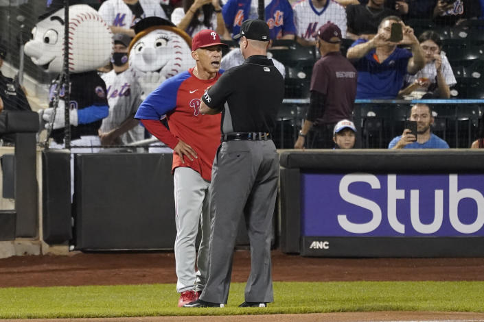 Philadelphia Phillies manager Joe Girardi, left, argues with umpire Carlos Torres during the seventh inning of a baseball game, Friday, Sept. 17, 2021, in New York. (AP Photo/Mary Altaffer)