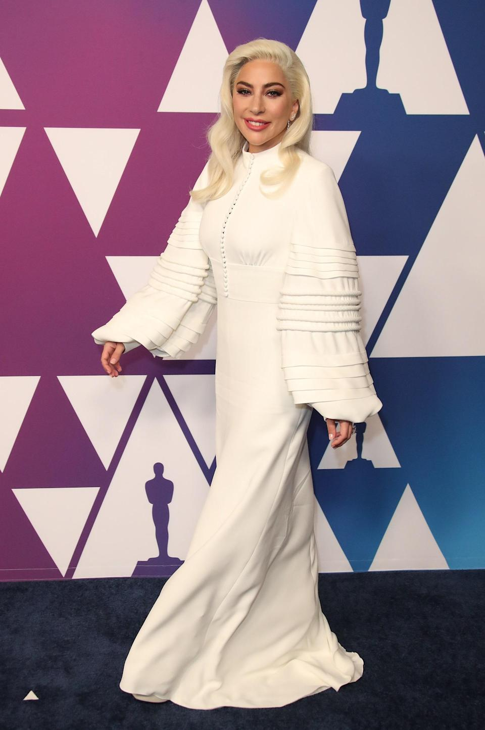 In this gorgeous white gown with intricate details, Gaga is the walking definition of our matriarch.