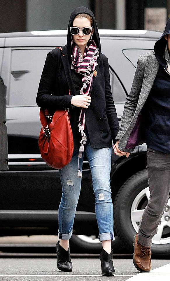 """A-list actress Anne Hathaway managed to make her hood chic by pairing it with a red Ferragamo hobo bag and trendy ankle booties. <a href=""""http://www.pacificcoastnews.com/"""" target=""""new"""">PacificCoastNews.com</a> - October 23, 2009"""