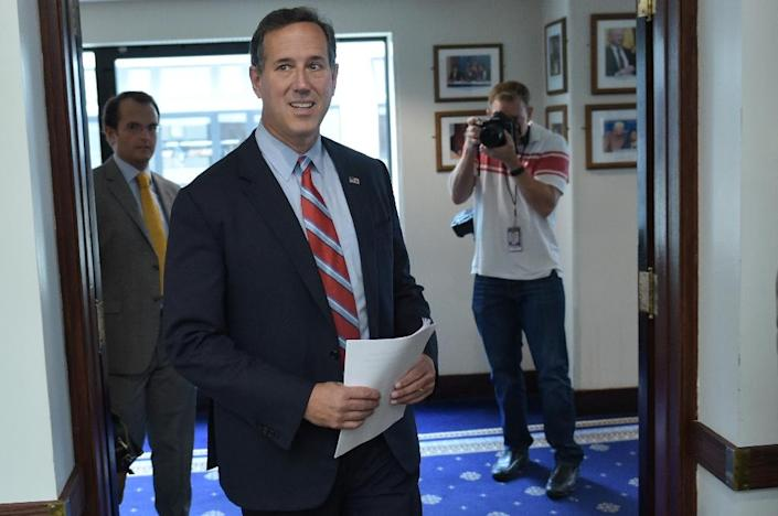 """Republican presidential hopeful Rick Santorum, who is polling at one percent, said he would ask Mexico to """"stop facilitating the lawlessness on the border and cooperate with our efforts"""" (AFP Photo/Mandel Ngan)"""