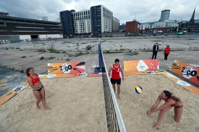 Team England players play beach volleyball during a demonstration at Smithfield in central Birmingham