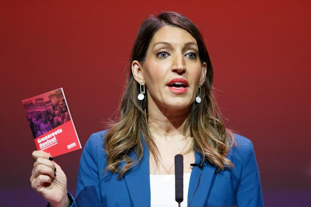 Dr Rosena Allin-Khan holds up her 'grassroots revival' plan for the Labour Party at a hustings in Glasgow last month. (Robert Perry/Getty Images)