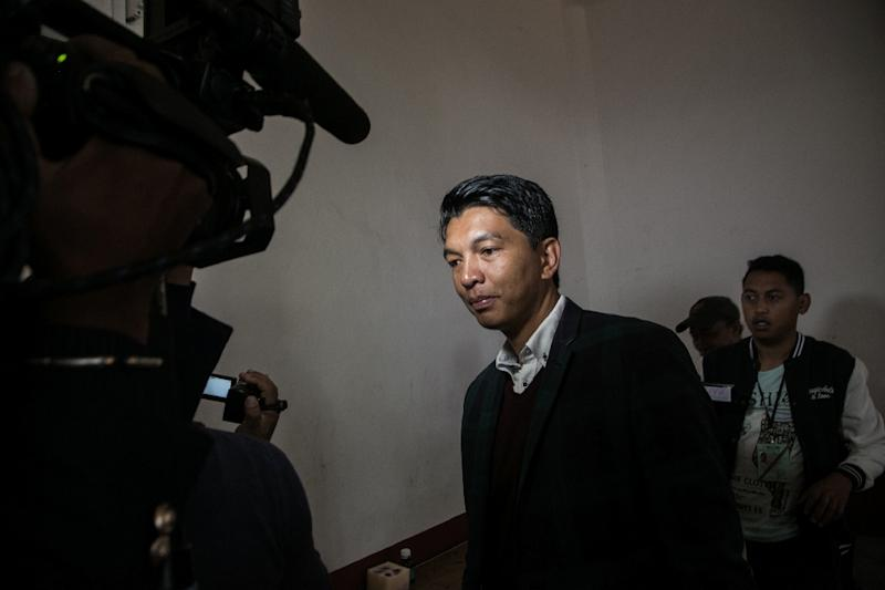 Madagascan President Andry Rajoelina's coalition, in a recent file image, has won an absolute majority in the new parliament, provisional data show, though the opposition is crying foul