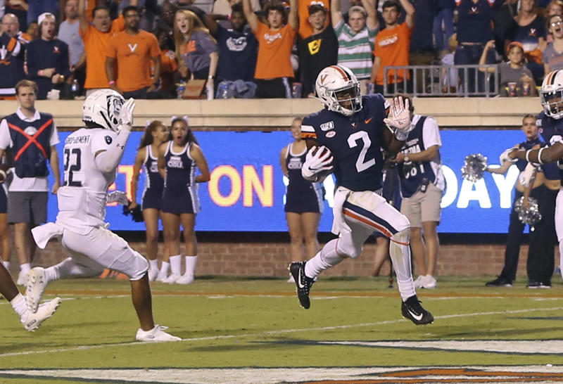 Virginia wide receiver Joe Reed (2) scores a touchdown in front of Old Dominion cornerback Kaleb Ford-Dement (22) during the fourth quarter of an NCAA college football game in Charlottesville, Va., Saturday, Sept. 21, 2019. (AP Photo/Andrew Shurtleff)