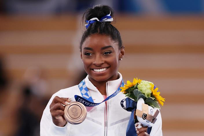<p>TOKYO, JAPAN - AUGUST 03: Simone Biles of Team United States poses with the bronze medal during the Women's Balance Beam Final medal ceremony on day eleven of the Tokyo 2020 Olympic Games at Ariake Gymnastics Centre on August 03, 2021 in Tokyo, Japan. (Photo by Jamie Squire/Getty Images)</p>