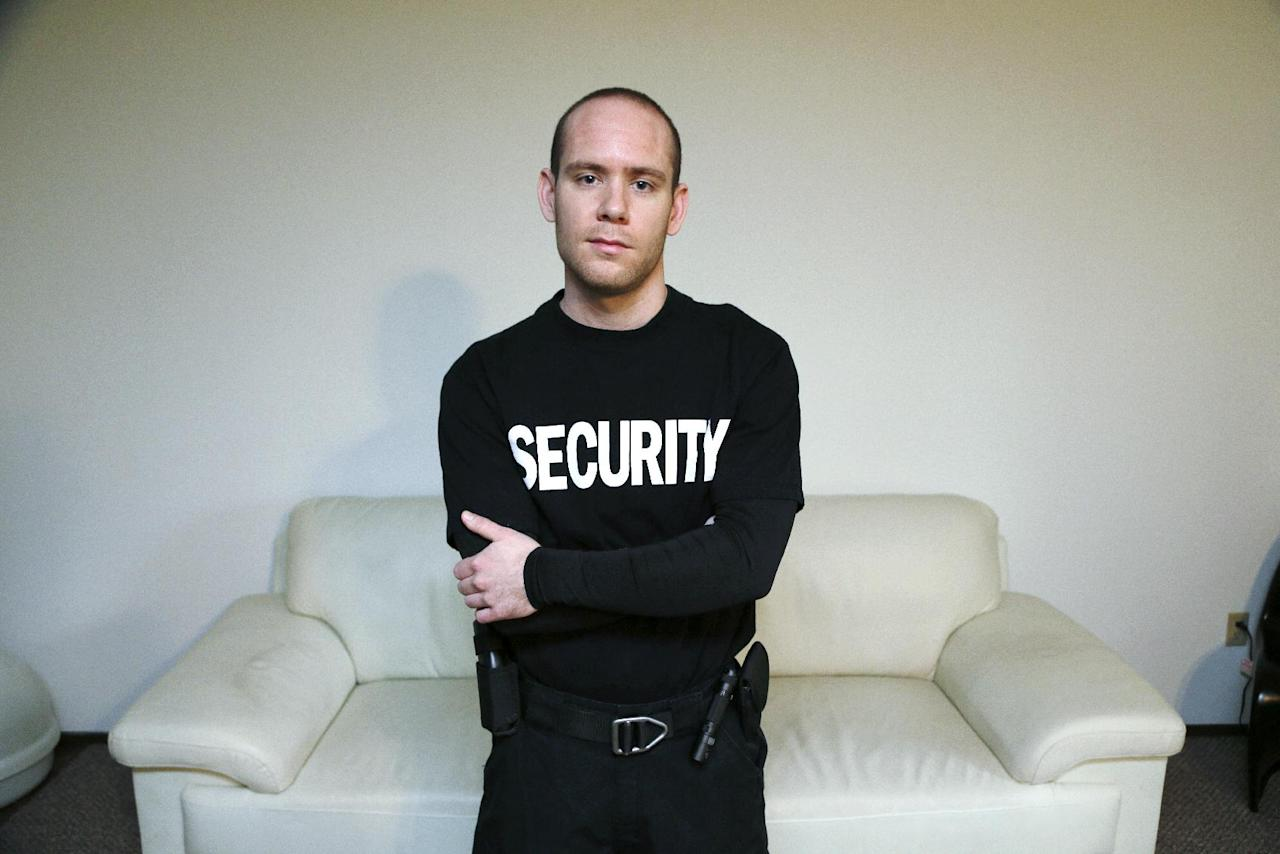 """Steve Smith poses at his home in Gig Harbor, Wash., Wednesday, Nov. 13, 2013. For a guy with a uniform and a gun, Smith was unusually welcome at medical marijuana dispensaries. Of course, he was a security guard, not a federal drug agent. Smith, 29, had a background in food marketing. His father worked for a large grocery cooperative in California. He earned a degree in agriculture business management and started marketing organic and natural products for a food broker. He liked thinking he was helping people eat better. A friend who was working in security suggested Smith do the same. Looking to keep busy and make some extra money, he took his training and became a certified security guard. The company that hired him happened to assign him to a couple of medical marijuana dispensaries. """"You can only work as a guard for so long before you want to open your own shop,"""" he says. He wants to apply to open two retail marijuana shops near Tacoma. (AP Photo/Ted S. Warren)"""
