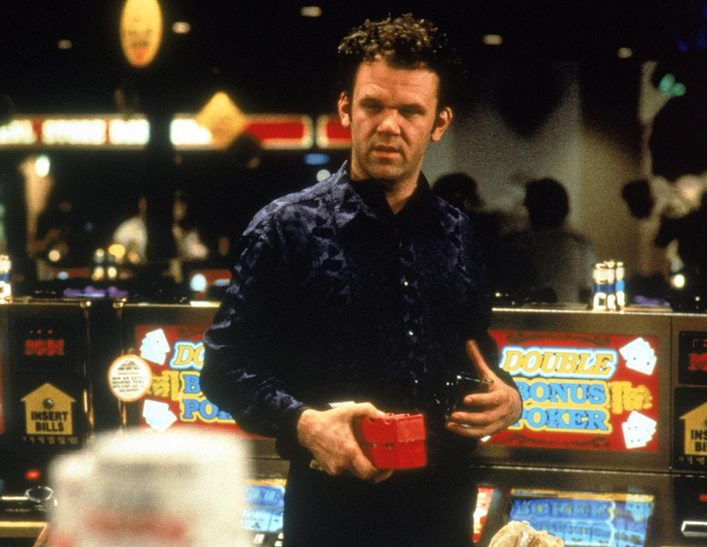 <p>Reilly is heartbreaking as a down-and-out loser who attempts —with minimal success —to make something of himself via his friendship with an older gambler (Philip Baker Hall) and a romance with a cocktail waitress (Gwyneth Paltrow). <i>Hard Eight</i> was the first of three collaborations with director Paul Thomas Anderson, and it may still be his finest dramatic turn to date. —Nick Schager (Photo: Everett) </p>