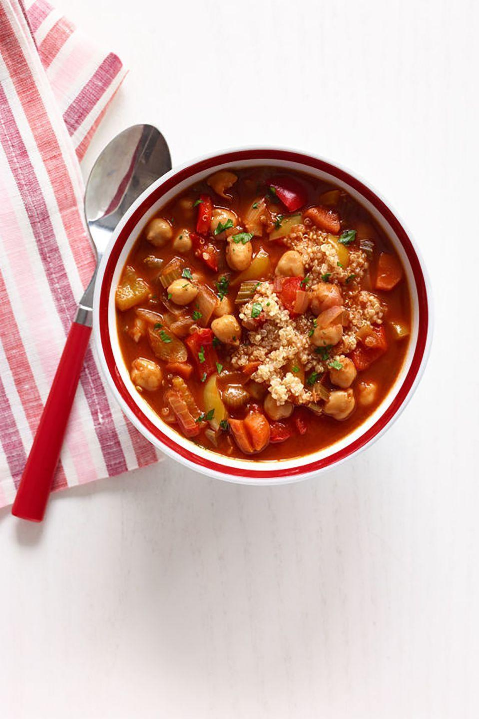 """<p>Nutty-flavored, protein-filled quinoa cooks together with seasoned vegetables for a tasty dinnertime soup.</p><p><strong><a href=""""https://www.countryliving.com/food-drinks/recipes/a34596/chickpea-red-pepper-soup-quinoa-recipe-wdy0214/"""" rel=""""nofollow noopener"""" target=""""_blank"""" data-ylk=""""slk:Get the recipe"""" class=""""link rapid-noclick-resp"""">Get the recipe</a>.</strong></p>"""