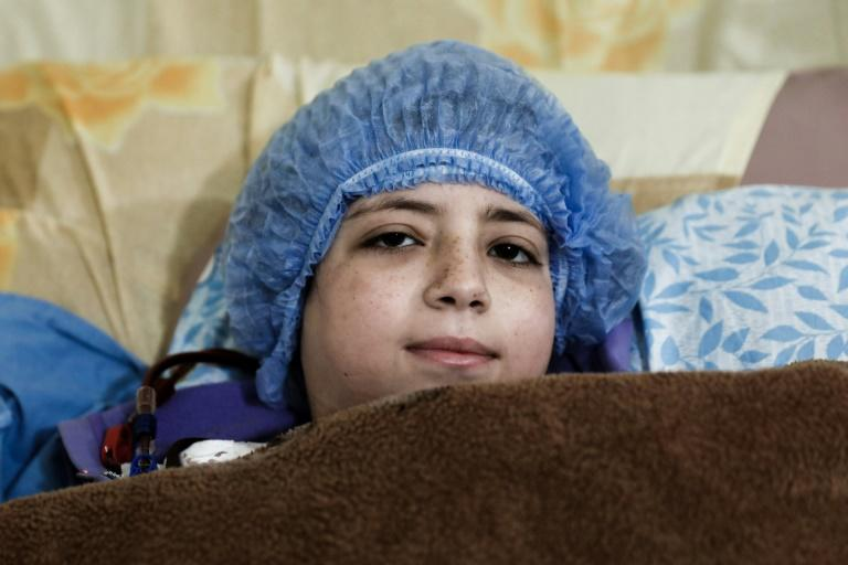 Dania, a 14-year-old Syrian who suffers from renal insufficiency, receives dialysis inside a basement-turned-clinic in the rebel-held Syrian town of Douma, on the outskirts of the capital Damascus, on March 16, 2017