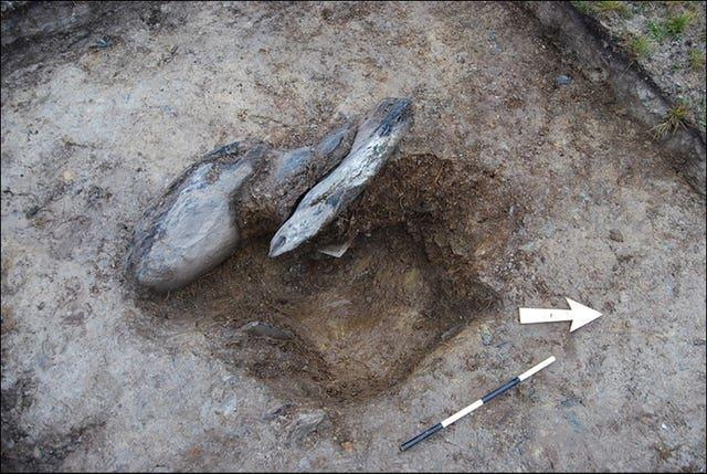 Archaeological excavation of a stonehole (Mike Parker Pearson/Antiquity Journal/PA)