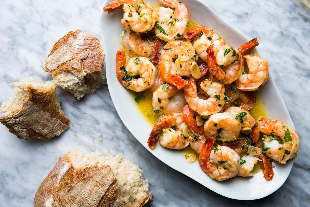 """We urge you: don't skip the marinade step—it really gives the shrimp lots of garlicky flavor and sets this apart from other scampi recipes. <a href=""""https://www.bonappetit.com/recipe/shrimp-scampi?mbid=synd_yahoo_rss"""">See recipe.</a>"""