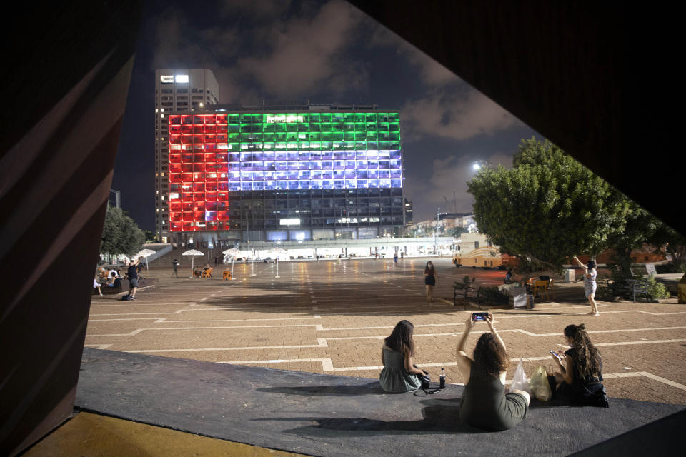 FILE - In this Thursday, Aug. 13, 2020, file photo, the Tel Aviv City Hall is lit up with the flag of the United Arab Emirates as Israel and the UAE announced they would be establishing full diplomatic ties, in Tel Aviv, Israel. Secret talks and quiet ties — that's what paved the way for last week's deal between the United Arab Emirates and Israel to normalize relations. Touted by President Donald Trump as a major Mideast breakthrough, the agreement was in fact the culmination of more than a decade of quiet links rooted in frenzied opposition to Iran that predated Trump and even Barack Obama, as well as Trump's avowed goal to undo his predecessor's Mideast legacy. (AP Photo/Oded Balilty, File)