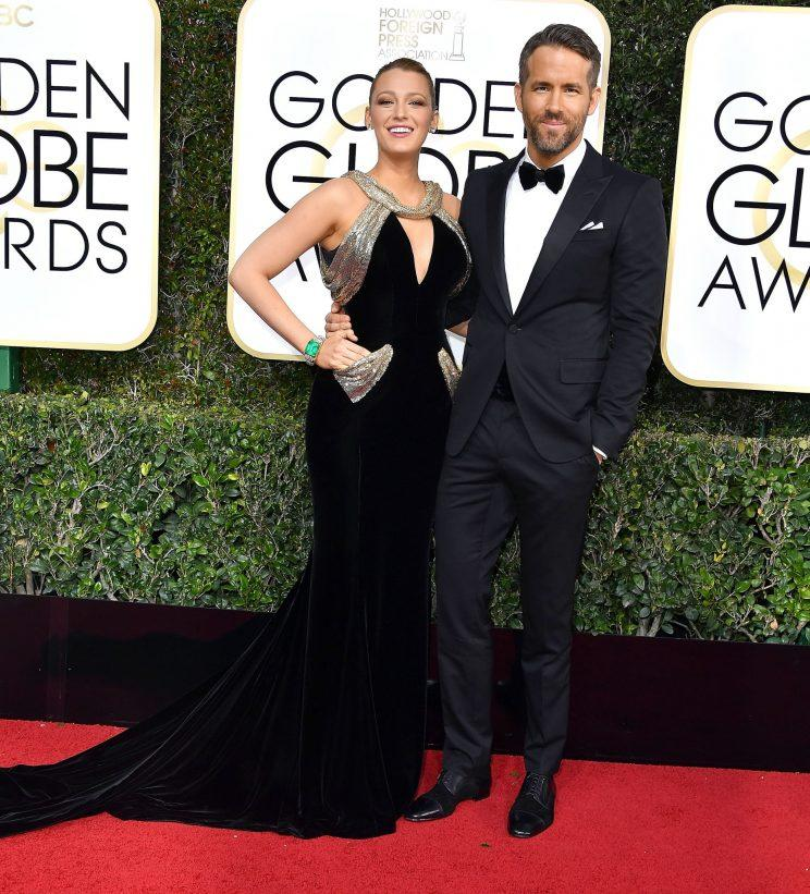 Blake Lively and Ryan Reynolds during the 74th Golden Globes Awards. (Photo: Getty Images.)