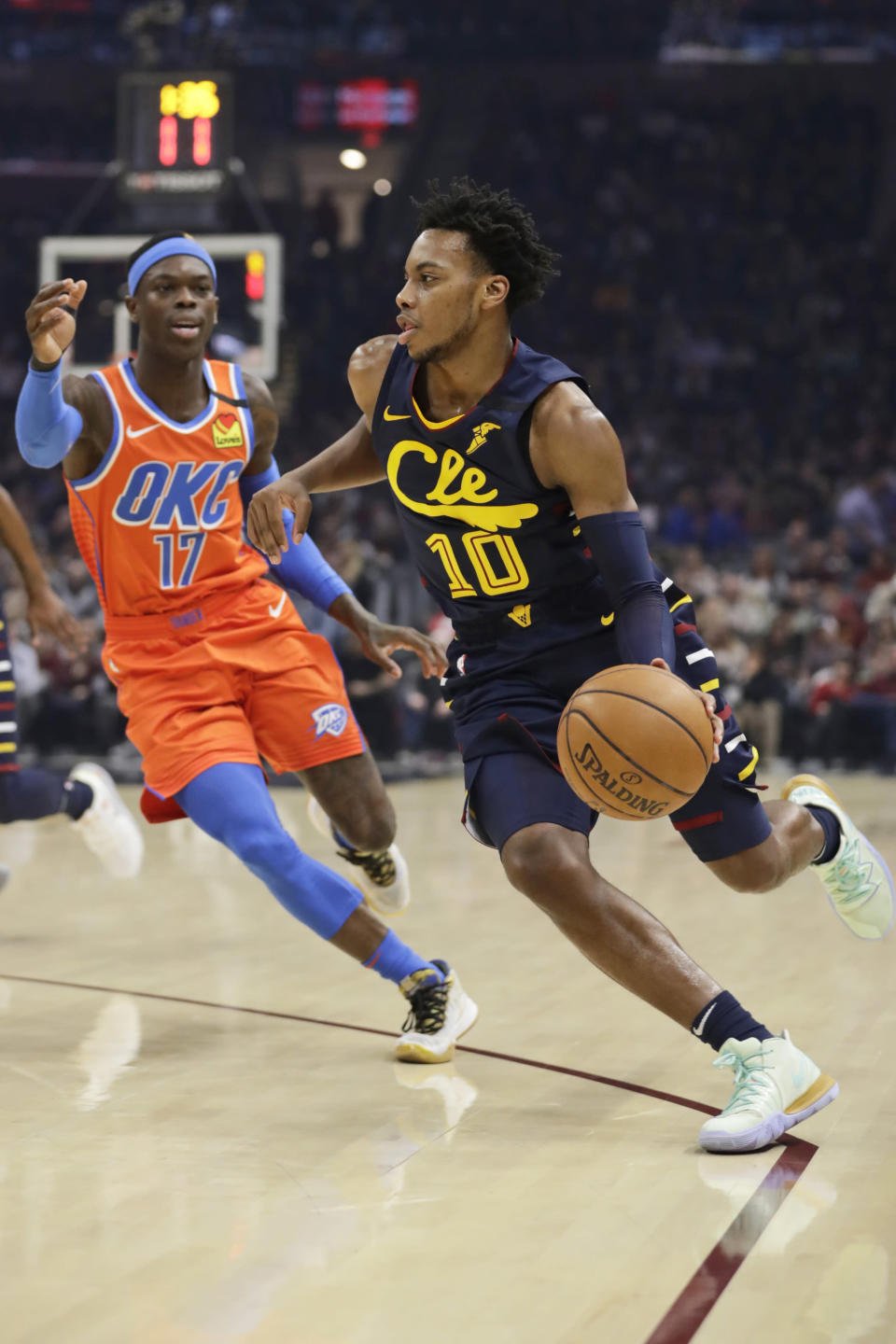 Cleveland Cavaliers' Darius Garland (10) drives past Oklahoma City Thunder's Dennis Schroder (17) in the first half of an NBA basketball game, Saturday, Jan. 4, 2020, in Cleveland. (AP Photo/Tony Dejak)