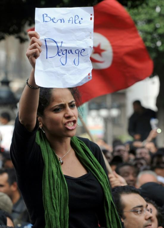 A photo of Ameni Ghimaji at a massive Tunis anti-regime rally made the front pages and became an iconic image of the youth in peaceful revolt