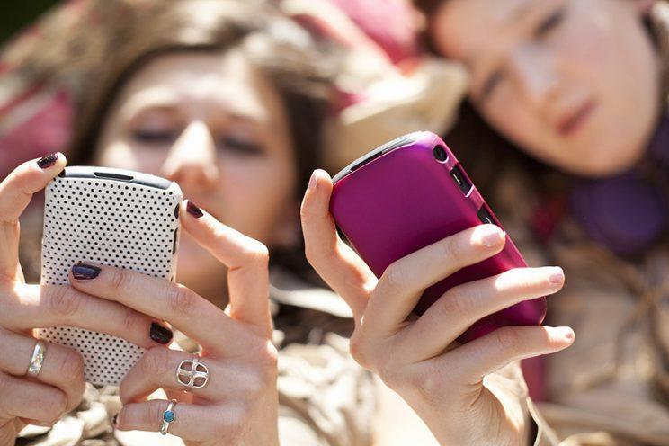 Teens often communicate via text using phrases and emojis with hidden meanings. (Photo: Getty Images)