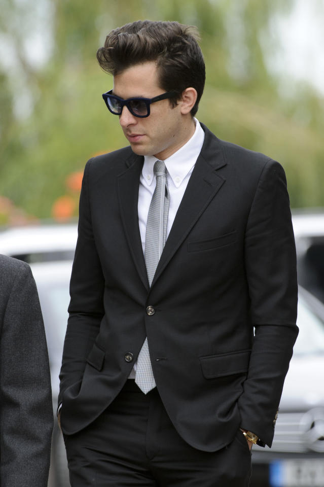 British producer Mark Ronson leaves Edgwarebury Cemetery, in London, Tuesday July 26, 2011, after attending the funeral of singer Amy Winehouse. The soul diva, who had battled alcohol and drug addiction, was found dead Saturday at her London home. She was 27. (AP Photo/Jonathan Short)