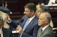 Rep. Sam Garrison, R-Fleming Island, left, and Rep. Bobby Payne, R-Palatka, answer questions on a gambling bill during a special session, Wednesday, May 19, 2021, in Tallahassee, Fla. (AP Photo/Steve Cannon)