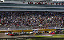 Cars round the track during a NASCAR Cup Series auto race at Las Vegas Motor Speedway, Sunday, Sept. 15, 2019. (AP Photo/Chase Stevens)