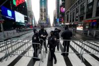 Police man checkpoints to prevent people from entering Times Square ahead of New Year's Eve