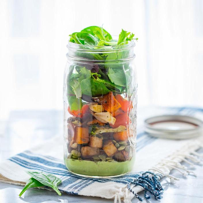 """<p>This vegan mason jar salad is easy to pack up and take for lunch. Layering the creamy cashew sauce into the bottom of the jar ensures that your big, bold power salad won't become wilted by the time you're ready to eat. <a href=""""https://www.eatingwell.com/recipe/262097/roasted-veggie-mason-jar-salad/"""" rel=""""nofollow noopener"""" target=""""_blank"""" data-ylk=""""slk:View Recipe"""" class=""""link rapid-noclick-resp"""">View Recipe</a></p>"""