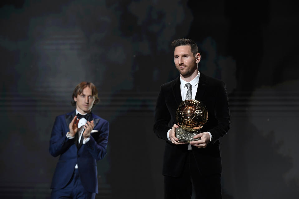 PARIS, FRANCE - DECEMBER 02: Lionel Messi (ARG / FC Barcelona) excepts his sixth Ballon D'Or award from Luka Modric during the Ballon D'Or Ceremony at Theatre Du Chatelet on December 02, 2019 in Paris, France. (Photo by Kristy Sparow/Getty Images)