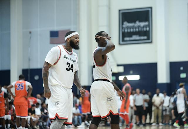 "Teammates Jayceon ""The Game"" Taylor and Franklin Session celebrate during a game. (Photo courtesy of Aaron Poole/Drew League)"