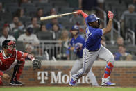 Toronto Blue Jays' Teoscar Hernandez swings for an RBI single in the eighth inning of a baseball game against the Atlanta Braves Tuesday, May 11, 2021, in Atlanta. (AP Photo/Ben Margot)