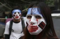Young demonstrators participate in an anti-coup mask strike in Yangon, Myanmar, Sunday, April 4, 2021. Threats of lethal violence and arrests of protesters have failed to suppress daily demonstrations across Myanmar demanding the military step down and reinstate the democratically elected government. (AP Photo)