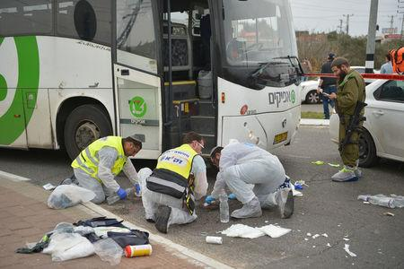 Rescue workers clean the scene following an incident at the entrance to the Jewish settlement of Ariel